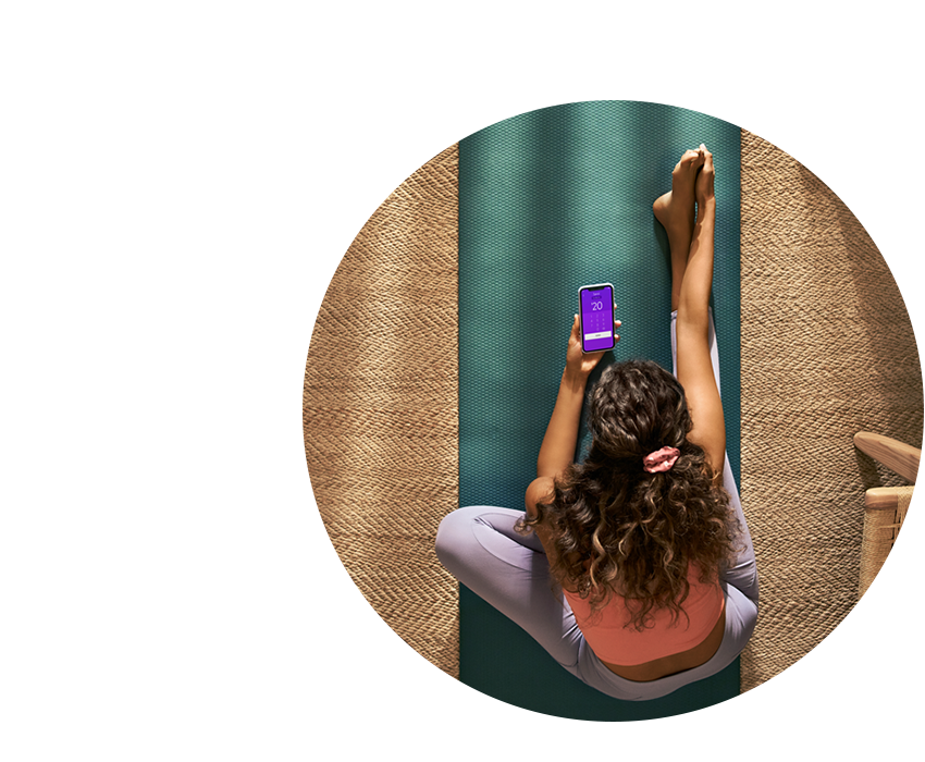 Woman Exercising and on a mobile phone using Zelle Pay app.